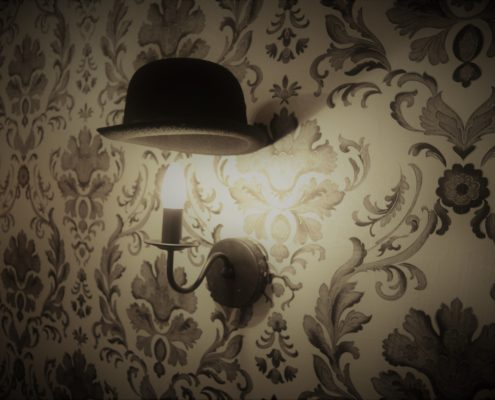 wall-with-lamp-and-a-hat